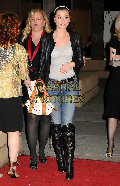 """HOLLY VALANCE.""""Blood River"""" Los Angeles Premiere held at Mann's Egyptian Theater, Hollywood, CA.24th March 2009..Full length jeans grey gray top brown tan bag knee high boots white black leather jacket belt pads padded gold studded .CAP/ADM/BP.©Byron Purvis/Admedia/Capital PIctures"""