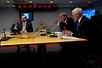 United States President Donald J. Trump speaks during a teleconference with governors at the Federal Emergency Management Agency headquarters, Thursday, March 19, 2020, in Washington, DC.  At left is US Secretary of Health and Human Services (HHS) Alex Azar and at right is US Vice President Mike Pence.<br /> Credit: Evan Vucci / Pool via CNP/AdMedia