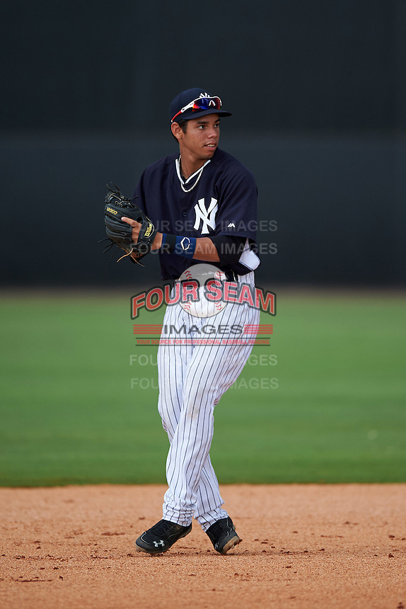 GCL Yankees 1 shortstop Danienger Perez (96) warmup throw to first during a game against the GCL Yankees 2 on July 29, 2015 at the Yankee Minor League Complex in Tampa, Florida.  The game was suspended after two innings due to rain.  (Mike Janes/Four Seam Images)