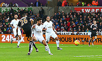 Riyad Mahrez of Leicester City scores a goal to make the score 0-2 during the Barclays Premier League match between Swansea City and Leicester City played at The Liberty Stadium on 5th December 2015
