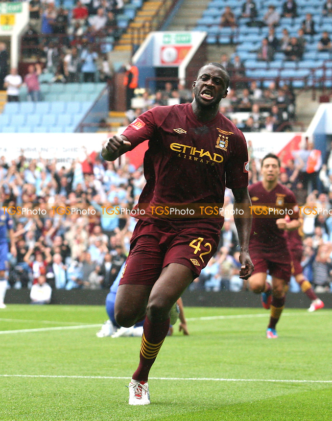 Yaya Toure of Manchester City celebrates scoring the equalising goal -  Chelsea vs Manchester City at the Villa Park Stadium - 12/08/12 - MANDATORY CREDIT: Dave Simpson/TGSPHOTO - Self billing applies where appropriate - 0845 094 6026 - contact@tgsphoto.co.uk - NO UNPAID USE.