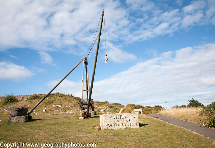 Antique crane forming monument to the quarrying heritage as the `Home of Portland Stone, Isle of Portland, Dorset, England, UK