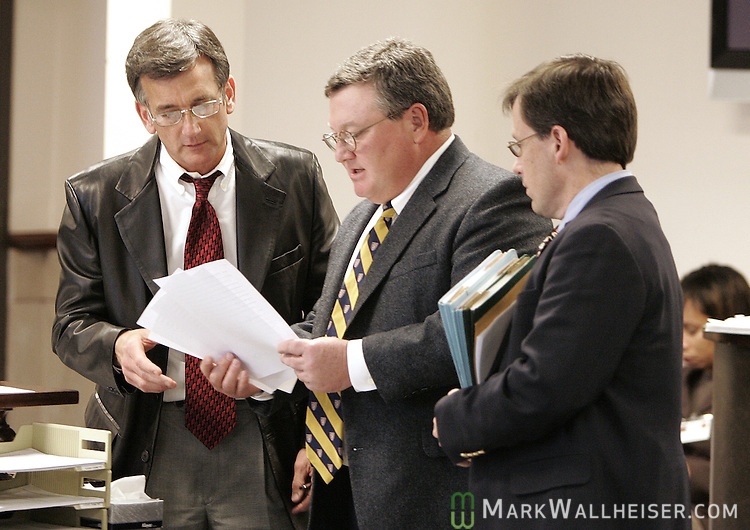 Defense attornys Waylon Graham, left, James White, center, and Jonathan Dingus, right, talk prior to the arraignment their clients who are three of the eight defendants in the Martin Lee Anderson case at the Bay County Courthouse in Panama City Thursday Jan. 18, 2007.  (Mark Wallheiser/TallahasseeStock.com)
