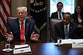 United States President Donald J. Trump speaks during a Cabinet Meeting in the Cabinet Room of the White House on November 19, 2019 in Washington, DC.  At right is US Secretary of Housing and Urban Development (HUD) Ben Carson.<br /> Credit: Oliver Contreras / Pool via CNP