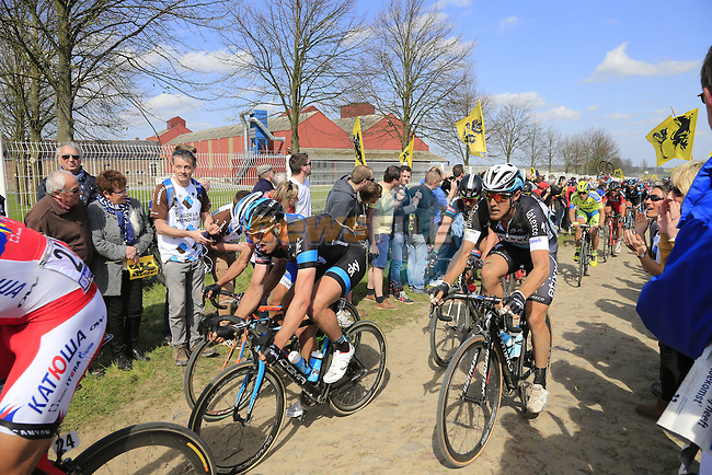 The peloton including Ian Stannard (GBR) Team Sky and Matteo Trentin (ITA) Etixx-Quick Step tackle Sector 10 Mons-en-Pevele during the 113th edition of the Paris-Roubaix 2015 cycle race held over the cobbled roads of Northern France. 12th April 2015.<br /> Photo: Eoin Clarke www.newsfile.ie