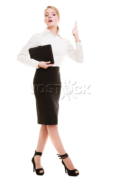 Full length of mad businesswoman boss. Furious teacher woman shaking an admonitory finger isolated. Studio shot.