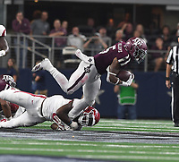 NWA Democrat-Gazette/J.T. WAMPLER Texas A&M's Trayveon Williams gets tackled Saturday Sept. 29, 2018 at AT&T Stadium in Arlington. The Aggies beat the Razorbacks 24-17.