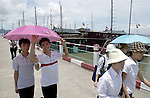 Halong-Vietnam, Ha Long - Viet Nam - 22 July 2005---Local tourists and passengers on the jetty for the boats to the famous Halong Bay, a UNESCO World Natural Heritage Site---tourism, traffic, transport, people---Photo: Horst Wagner/eup-images