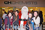 SANTA FUN: Having fun with Santa at the CH Chemist festive evening on Friday l-r: Laura Switzer, Rachel Quirke, Santa Clause, Zoe Riordan and Chantele O'Sullivan.