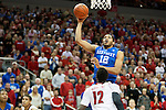 Center Karl-Anthony Towns of the Kentucky Wildcats shoots over a defender during the game against  the Louisville Cardinals at KFC Yum! Center on Saturday, December 27, 2014 in Louisville `, Ky. Kentucky defeated Louisville 58-50. Photo by Michael Reaves | Staff