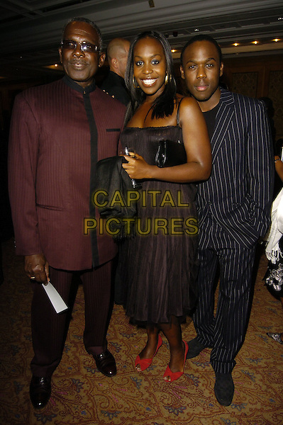 RUDOLPH WALKER, PETRA LETANG & MOHAMMED GEORGE.Gift Of Life VII Charity Dinner, Royal Lancaster Hotel, London, England, September 16th 2006..full length black dress red shoes bows.Ref: CAN.www.capitalpictures.com.sales@capitalpictures.com.©Can Nguyen/Capital Pictures