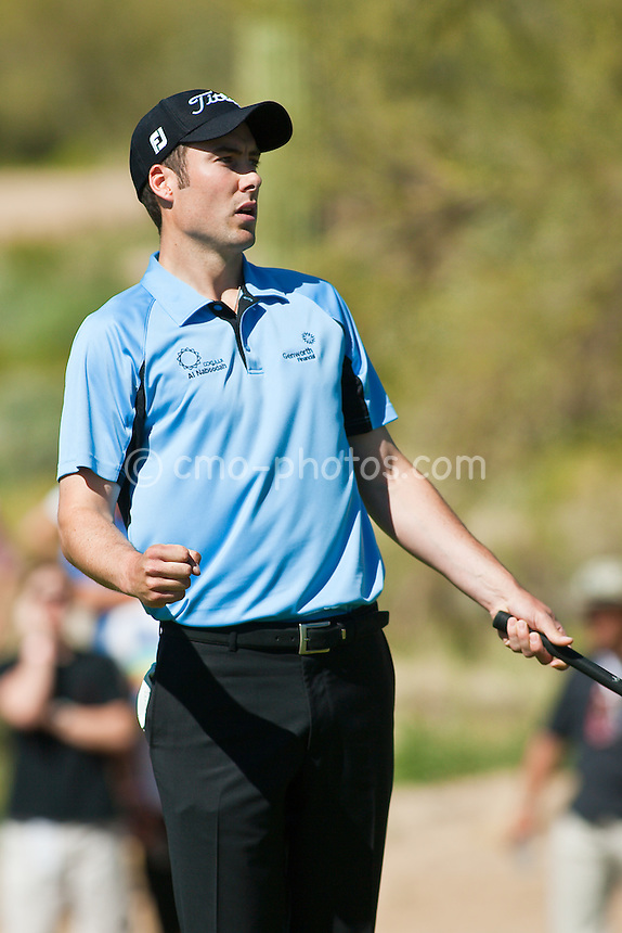 Feb 28, 2009; Marana, AZ, USA; Ross Fisher (ENG) reacts to sinking a putt to win his match against Justin Leonard (USA), not pictured, on the 17th hole during the quarterfinal round of the World Golf Championships-Accenture Match Play Championship at the Ritz-Carlton Golf Club, Dove Mountain.