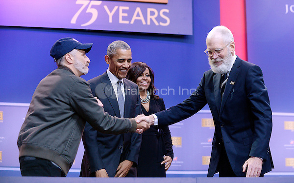 Comedian Jon Stewart checks hands with David Letterman as United States President Barack Obama and First Lady Michelle Obama look on at the kick off of the 5th anniversary of Joining Forces and the 75th anniversary of the USO at Joint Base Andrews on May 5, 2016 in Maryland. <br /> Credit: Olivier Douliery / Pool via CNP/MediaPunch
