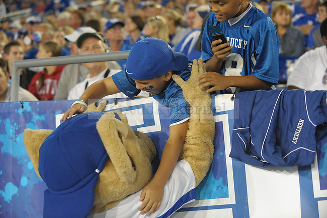 UK mascot Scratch hugs a young fan during the second half of the University of Kentucky football game against Louisville at Commonwealth Stadium in Lexington, Ky., on 9/17/11. UK lost the game 17-24. Photo by Mike Weaver | Staff