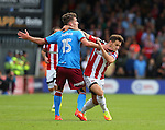 Harry Toffolo of Scunthorpe Utd tussles with Billy Sharp of Sheffield Utd during the English League One match at Glanford Park Stadium, Scunthorpe. Picture date: September 24th, 2016. Pic Simon Bellis/Sportimage
