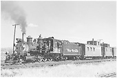 3/4 fireman's-side view of D&amp;RGW #278 switching the Gunnison yards with cabooses #0588 and #0524 plus freight cars.<br /> D&amp;RGW  Gunnison, CO  Taken by Richardson, Robert W. - 9/24/1951