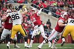 Wisconsin Badgers quarterback Alex Hornibrook (12) throws a pass during an NCAA College Big Ten Conference football game against the Iowa Hawkeyes Saturday, November 11, 2017, in Madison, Wis. The Badgers won 38-14. (Photo by David Stluka)