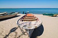 Fishing boat pulled ashore on beach along Sea of Cortez, La Paz, Baja Mexico