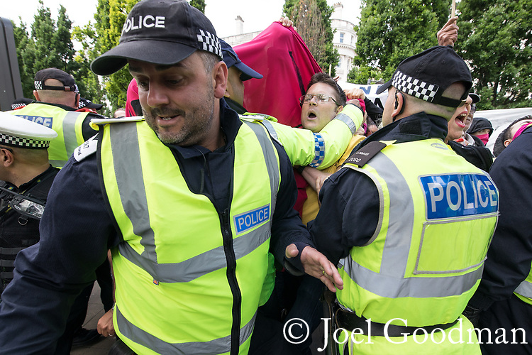 """© Joel Goodman - 07973 332324 . 11/06/2017 . Manchester , UK . Police separate anti fascists from the demonstration . Demonstration against Islamic hate , organised by former EDL leader Tommy Robinson's """" UK Against Hate """" and opposed by a counter demonstration of anti-fascist groups . UK Against Hate say their silent march from Piccadilly Train Station to a rally in Piccadilly Gardens in central Manchester is in response to a terrorist attack at an Ariana Grande concert in Manchester , and is on the anniversary of the gun massacre at the Pulse nightclub in Orlando . Photo credit : Joel Goodman"""