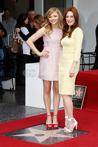 HOLLYWOOD, CA - OCTOBER 03: Chloe Grace Moretz and Actress Julianne Moore, as she is honored with a star on the Hollywood Walk of Fame on October 3, 2013 in Hollywood, California. Credit: Sonboleh/RTN/MediaPunch Inc.