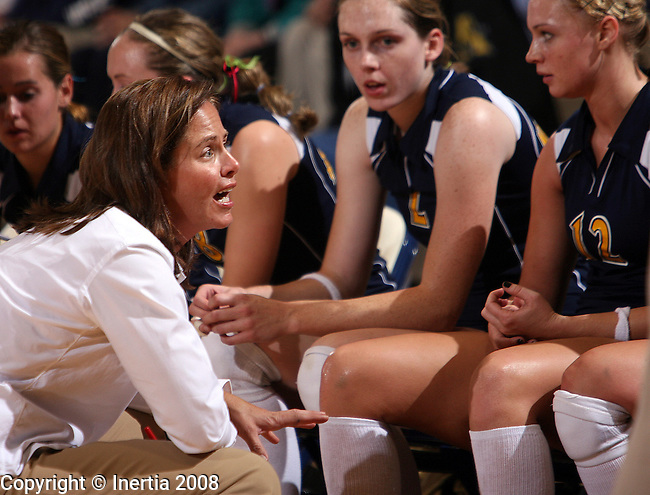 SIOUX FALLS, SD - May 13; Augustana coach Kim Sudbeck, left, talks to her players during a time out in their game against Southwest Minnesota State in September. Sudbeck announced her resignation as head volleyball coach at Augustana after amassing a 287-122 record over 13 seasons including four NCC titles, 11 NCAA playoff appearances over the past 12 seasons, one North Central Region Championship and Augustana's first appearance in the 2000 Elite Eight Championship finishing with a national runner-up. Assistant coach Ashley Buckley has been named as the Vikings new coach. (Photo by Dave Eggen/Inertia)
