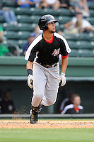 Outfielder Nomar Mazara (12) of the Hickory Crawdads bats in a game against the Greenville Drive on Sunday, June 9, 2013, at Fluor Field at the West End in Greenville, South Carolina. Mazara is the No. 16 prospect of the Texas Rangers, according to Baseball America. Hickory won, 6-3. (Tom Priddy/Four Seam Images)