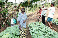 Members of the community farming group at work in their community fields near the town of Masi Manimba, Bandundu Province, DRC. Since receiving some training on healthier eating and nutrition from the NGO Action Against Hunger, the community organised itself into voluntary groups and came up with the idea for a co-operative farm. It now produces enough food to feed the 35 families in the community whilst still leaving them enough to sell at the local market.