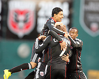 Adam Cristman #7 of D.C. United  is surrounded by Cristian Castillo #12 and Rodney Wallace #22 after scoring the first goal for United during a US Open Cup match against F.C. Dallas on April 28 2010, at RFK Stadium in Washington D.C. United won 4-2.