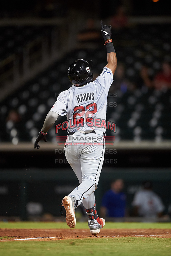 Scottsdale Scorpions Trey Harris (22), of the Atlanta Braves organization, celebrates as he crosses home plate after hitting a home run during an Arizona Fall League game against the Mesa Solar Sox on September 18, 2019 at Sloan Park in Mesa, Arizona. Scottsdale defeated Mesa 5-4. (Zachary Lucy/Four Seam Images)