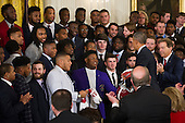 United States President Barack Obama (right) greets members of the Alabama Crimson Tide football team following a ceremony to honor their 2015- 2016 College Football Playoff National Championship, in the East Room at The White House in Washington, D.C., Wednesday, March 2, 2016. <br /> Credit: Rod Lamkey Jr. / Pool via CNP