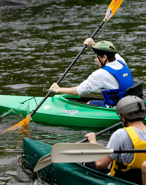 WATERBURY, CT. 05 May 2012-050512SV10-John Fanotto of Seymour digs into the water at the start of the fifth annual Naugatuck Valley River Race on the Naugatuck River in Waterbury Saturday. Two popular Naugatuck Valley events, the fifth annual River Race and the 14th annual Riverfest Duck Race, combined this year. The paddling ended six miles south before the Depot Street Bridge in Beacon Falls where the duck race took place..Steven Valenti Republican-American