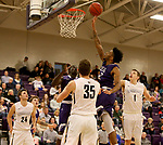 SIOUX FALLS, SD - DECEMBER 31: Justin Taylor #22 from the University of Sioux Falls tips the ball in for two points against Augustana University during their game Sunday afternoon December 31, 2017 at the Stewart Center in Sioux Falls, SD.  (Photo by Dave Eggen/Inertia)