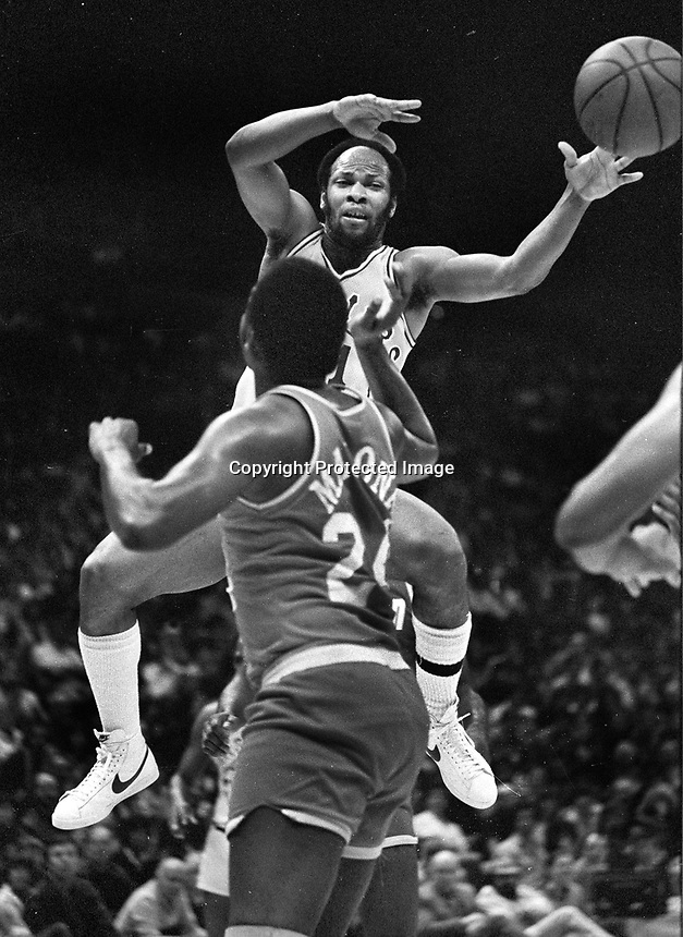 Warriors World B. Free against Moses Malone...(1982 photo/Ron Riesterer)