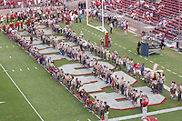 Stanford - September 13, 2014: Scouts line up during the opening ceremonies before the Stanford vs Army football game Saturday afternoon at Stanford Stadium.<br /> <br /> Stanford won 35-0.