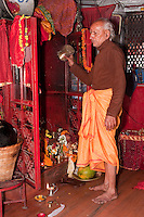 Kathmandu, Nepal.  Hindu Priest in Neighborhood Shrine.