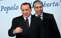 Il leader del Popolo della Liberta' Silvio Berlusconi arriva alla manifestazione dei Popolari Liberali a Roma, 23 febbraio 2008, accolto da Carlo Giovanardi, sullo sfondo..Leader of the People of Freedom Silvio Berlusconi arrives for an electoral rally in Rome, 23 february 2008, welcomed by lawmaker Carlo Giovanardi, on background..UPDATE IMAGES PRESS/Riccardo De Luca