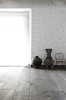 The dark parquet strips laid down throughout the property have been sanded to enhance the pattern and veins of the wood