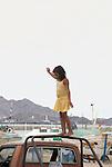 YOUNG GIRL IN SAN FELIPE HARBOR BALANCES ON TRUCK