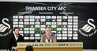 Head coach Francesco Guidolin (C) with assistant Gabriele Abrosetti (L) during the Swansea City FC press conference at the Liberty Stadium, Swansea on Thursday, January 28 2016