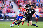 Angel Correa of Atletico de Madrid (L) fights for the ball with Paulo Oliveira of SD Eibar (R) during the La Liga match between Atletico Madrid and Eibar at Wanda Metropolitano Stadium on May 20, 2018 in Madrid, Spain. Photo by Diego Souto / Power Sport Images