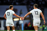 Henry Slade of England high-fives team-mate Sam Burgess. QBE International match between England and France on August 15, 2015 at Twickenham Stadium in London, England. Photo by: Patrick Khachfe / Onside Images