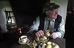 tITLE; 'THE PEOPLE WHO EAT THEIR DINNER IN THE MIDDLE OF THE DAY'<br />Jackie Healy-Rae prepares his spuds for the dinner in the middle of the day.<br />One of the images from Don MacMonagle's book of 100 photographs of Deputy Jackie Healy-Rae entitled 'Jackie - Keeping Up Appearance'.<br />Picture by Don MacMonagle