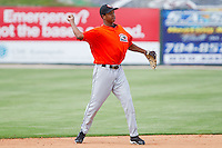 Jonathan Schoop #46 of the Delmarva Shorebirds makes a throw to first base during batting practice prior to the game against the Kannapolis Intimidators at Fieldcrest Cannon Stadium on May 20, 2011 in Kannapolis, North Carolina.   Photo by Brian Westerholt / Four Seam Images