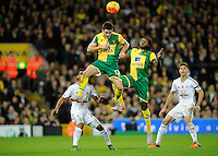 Robbie Brady and Dieumerci Mbokani of Norwich City go for the ball during the Barclays Premier League match between Norwich City and Swansea City played at Carrow Road, Norwich on November 7th 2015