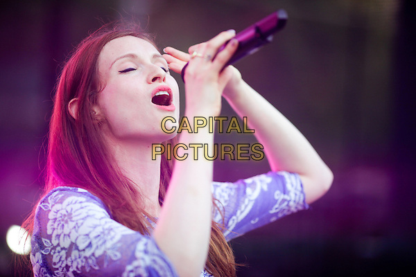 Sophie Ellis Bextor.Presentation of the TV channel 'Friday', Hermitage Garden, Moscow,.Russia, 7th August 2012..music live on stage performing performs concert gig half length blue lace dress white microphone singing eyes shut mouth open closed hand .CAP/PER/AS.©AS/PersonaStars/CapitalPictures
