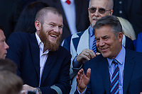Injured Cardiff player Aron Gunnarsson enjoys a joke with Cardiff chairman Mehmet Dahlman after the Sky Bet Championship match between Cardiff City and Reading at the Cardiff City Stadium, Cardiff, Wales on 6 May 2018. Photo by Mark  Hawkins / PRiME Media Images.