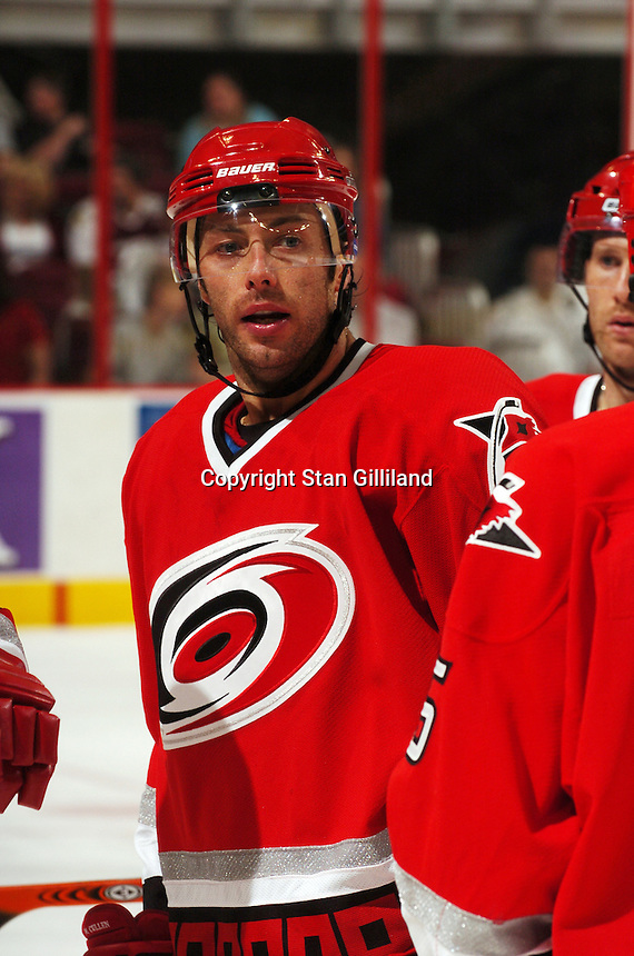 Carolina Hurricanes' Matt Cullen talks with teammates during a game with the Tampa Bay Lightning Thursday, Sep. 22, 2005 in Raleigh, NC. Carolina won 5-2.