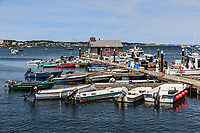 Boats docked at McMillan Wharf pier, Provincetown, Cape Cod, Massachusetts, USA.