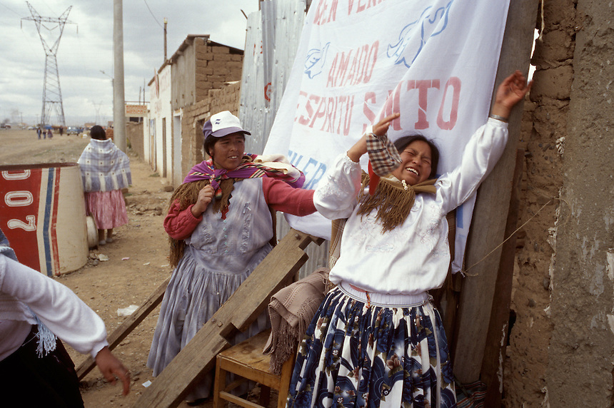 An Aymara Indian woman in the La Paz suburb of El Alto is overcome by alleged demonic spirits as the pastor of a road-side Pentecostal church performs a mass exorcism on his congregation. The dramatic, often frenzied services at some churches proves attractive to many who feel disconnected from the pomp and tradition of Catholicism.
