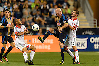 Conor Casey (6) of the Philadelphia Union is marked by Perry Kitchen (23) of D. C. United during a Major League Soccer (MLS) match at PPL Park in Chester, PA, on August 10, 2013.